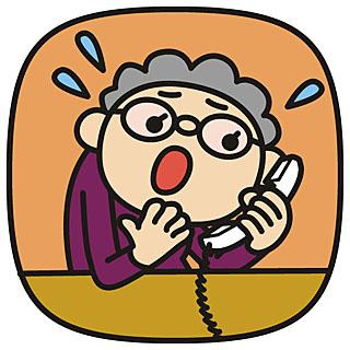 電話対応で慌てるおばあさんの画像